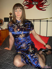 Click here to view the full gallery I've had an urge for the tender touch of a sexy crossdresser lately and i needed to scratch that itch! I want to be the man in this scene and get my wicked way with a real sissy whore so i put on a mans smart shirt that hides my sexy lingerie underneath. My nasty little sissy was dressed in a sexy and tight chinese dress. Her natural curves looked stunning and i could see her stocking covered legs peaking out the bottom of it. She asked me if i preffered brunettes or blondes and i told her i wanted to see her as both. She quickly changed wigs and i decided that i didn't care, she looked like a sexy transvestite whore anyway and i could feel my nipples getting hard under this shirt. I pulled out one of my firm tits and she started to suck and lick it. I held her by the back of her head and pulled her deeper and deeper into my chest, feeling so dominant made my pussy so wet and this little sissy would be lapping it up soon enough. What a great day. Join Nylon Jane Today Welcome to Nylon Jane and her world of leg, stocking, nylon and tranny fetish. Let her introduce you to all things nylon!